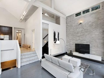 Split-level living room using black colours with tiles & fireplace - Living Area photo 250532