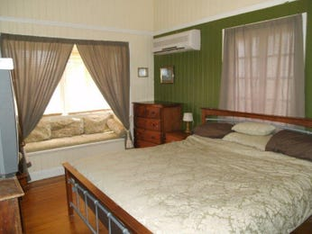Classic bedroom design idea with floorboards & bi-fold windows using green colours - Bedroom photo 413427