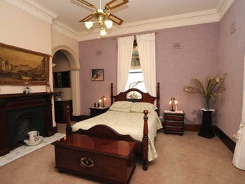 Period bedroom design idea with carpet & fireplace using beige colours - Bedroom photo 402453