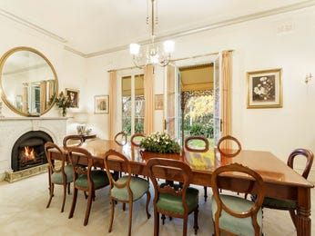 Classic dining room idea with hardwood & fireplace - Dining Room Photo 8766073