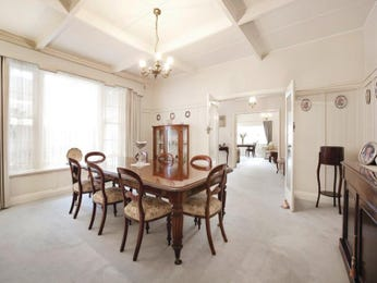 Classic dining room idea with floorboards & louvre windows - Dining Room Photo 450362