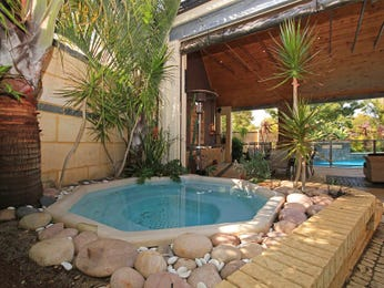 Indoor pool design using natural stone with outdoor dining & latticework fence - Pool photo 253693