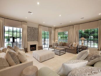 Open plan living room using beige colours with carpet & fireplace - Living Area photo 256047