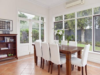 Casual dining room idea with hardwood & bi-fold doors - Dining Room Photo 1543525