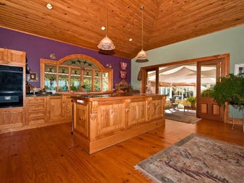 Country single-line kitchen design using floorboards - Kitchen Photo 390157