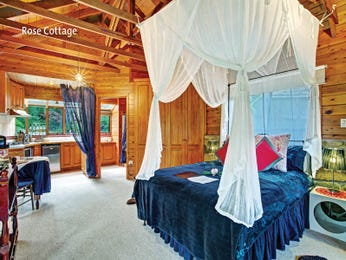 Country bedroom design idea with timber & exposed eaves using blue colours - Bedroom photo 8727769