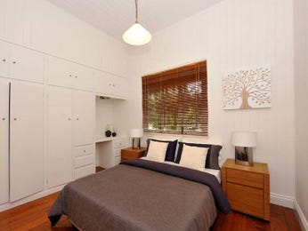 Classic bedroom design idea with floorboards & built-in shelving using brown colours - Bedroom photo 459755