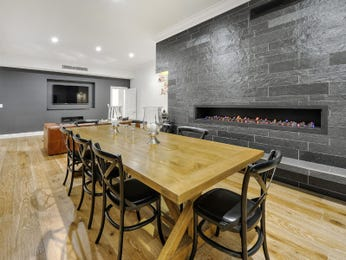 Modern dining room idea with floorboards & fireplace - Dining Room Photo 7638189