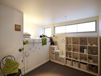 Modern bedroom design idea with carpet & built-in shelving using cream colours - Bedroom photo 306525