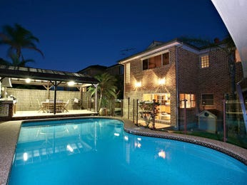 In-ground pool design using brick with pool fence & latticework fence - Pool photo 370830