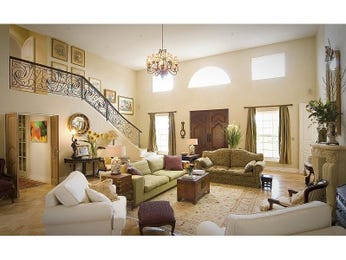 Open plan living room using brown colours with carpet & bay windows - Living Area photo 441698