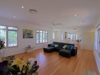 Dining-living living room using cream colours with floorboards & louvre windows - Living Area photo 346724