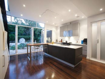 Modern open plan kitchen design using floorboards - Kitchen Photo 8502485