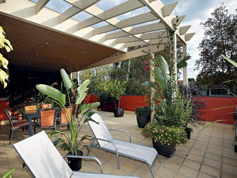 Indoor-outdoor outdoor living design with spa & latticework fence using tiles - Outdoor Living Photo 463962