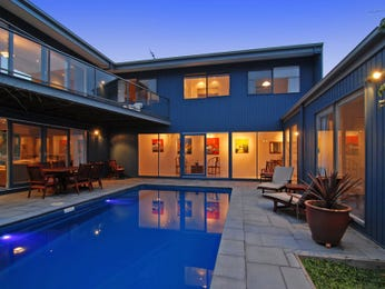 In-ground pool design using pavers with decking & outdoor furniture setting - Pool photo 308887