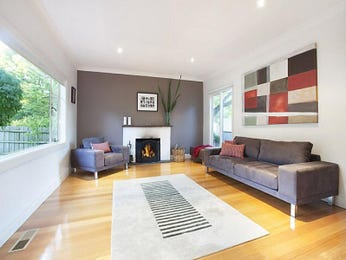 Open plan living room using white colours with timber & fireplace - Living Area photo 426955