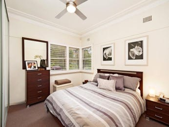 Period bedroom design idea with floorboards & louvre windows using beige colours - Bedroom photo 591647