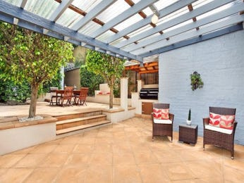 Multi-level outdoor living design with bbq area & outdoor furniture setting using pavers - Outdoor Living Photo 936077