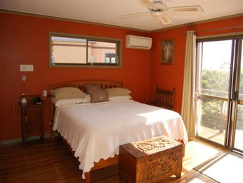 Classic bedroom design idea with hardwood & balcony using red colours - Bedroom photo 974915