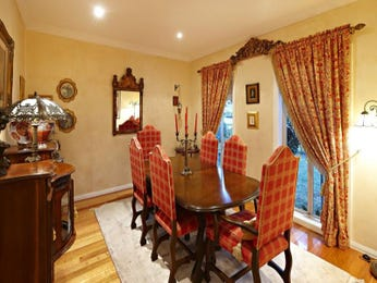 Classic dining room idea with hardwood & french windows - Dining Room Photo 1043846