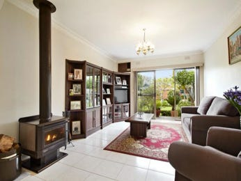 Open plan living room using neutral colours with tiles & fireplace - Living Area photo 727413