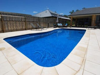 Low maintenance pool design using tiles with pool fence & outdoor furniture setting - Pool photo 887274