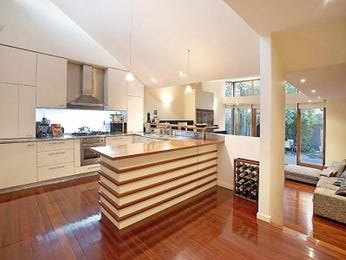 Classic L Shaped Kitchen Design Using Floorboards