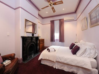 Classic bedroom design idea with carpet & fireplace using brown colours - Bedroom photo 1555143