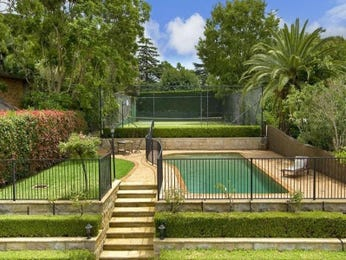 In-ground pool design using grass with pool fence & outdoor furniture setting - Pool photo 1487776
