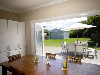 Classic dining room idea with slate & bi-fold doors - Dining Room Photo 1068674