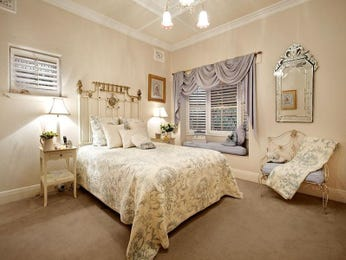 Period bedroom design idea with carpet & window seat using brown colours - Bedroom photo 935042