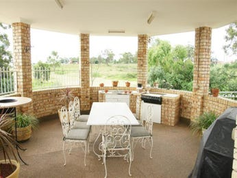 Enclosed outdoor living design with bbq area & outdoor furniture setting using brick - Outdoor Living Photo 1149968