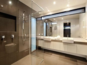 Modern bathroom design with twin basins using glass for Main bathroom designs