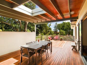 Enclosed outdoor living design with deck & latticework fence using timber - Outdoor Living Photo 944385