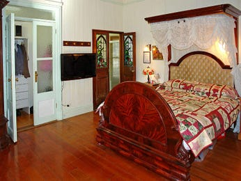 Romantic bedroom design idea with floorboards & bi-fold doors using beige colours - Bedroom photo 751389