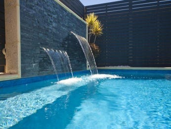 In-ground pool design using bluestone with pool fence & hedging - Pool photo 983796