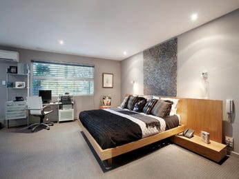 Modern bedroom design idea with carpet & built-in shelving using beige colours - Bedroom photo 1045592