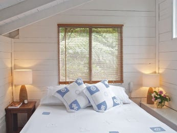 Country bedroom design idea with timber & exposed eaves using blue colours - Bedroom photo 1191036
