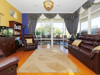 Split-level living room using yellow colours with carpet & french doors - Living Area photo 501803