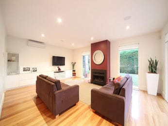 Open plan living room using silver colours with carpet & bay windows - Living Area photo 314960