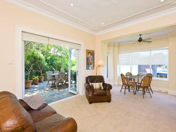 Open plan living room using beige colours with carpet & bi-fold doors - Living Area photo 1092470
