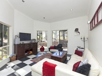 Open plan living room using black colours with carpet & bay windows - Living Area photo 703368