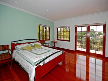 Country bedroom design idea with floorboards & balcony using brown colours - Bedroom photo 560901