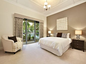 Classic bedroom design idea with floorboards & french doors using beige colours - Bedroom photo 1223523