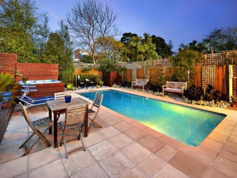 In-ground pool design using natural stone with bbq area & decorative lighting - Pool photo 582610