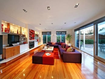 Open plan living room using silver colours with carpet & bi-fold doors - Living Area photo 409352