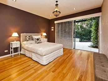 Romantic bedroom design idea with hardwood & balcony using beige colours - Bedroom photo 741600