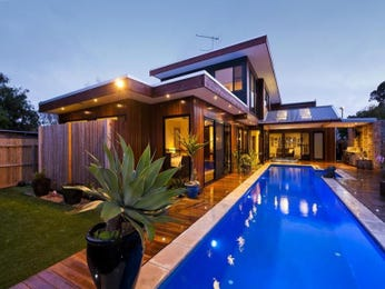 In-ground pool design using grass with cabana & decorative lighting - Pool photo 932397