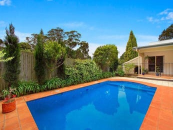In-ground pool design using brick with decking & hedging - Pool photo 675695