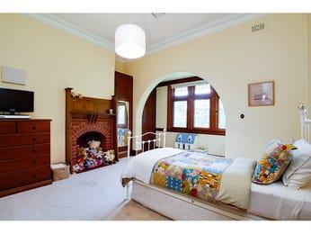 Children's room bedroom design idea with carpet & fireplace using cream colours - Bedroom photo 553956